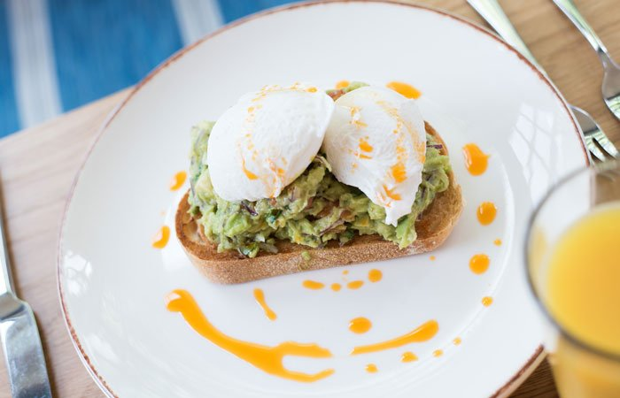 Smashed avocado on toast breakfast from the anglers pub and restaurant teddington
