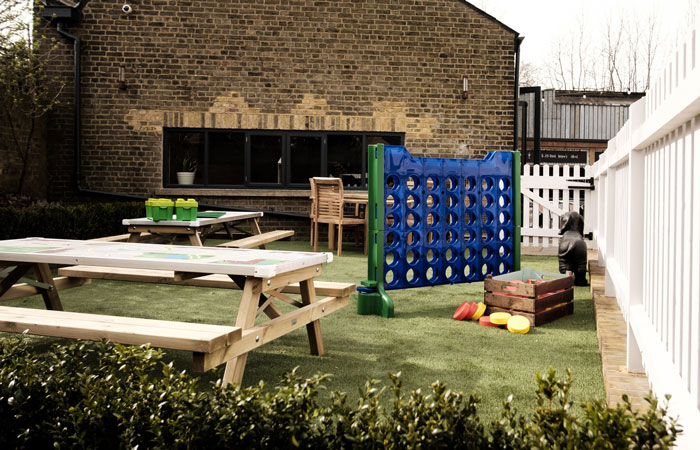 Garden bar and children's play area at The Half Moon pub Herne Hill London