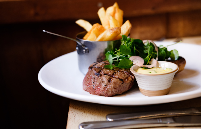 steak, fries and salad at Fuller's kitchen pub England