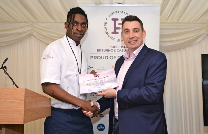 Fuller's Chefs' Guild Apprentice Shey Soetan receives his certificate of recognition.