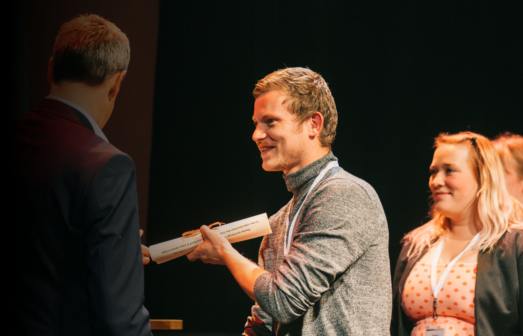 Fuller's staff member receiving graduation certificate at ceremony