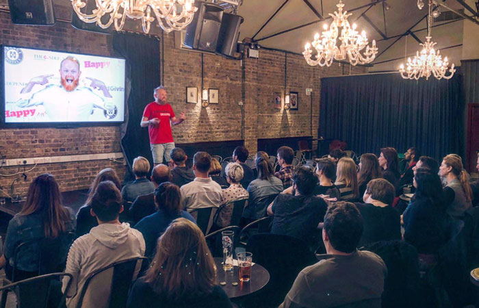 Danny Bent giving a talk at a Fuller's pub in London