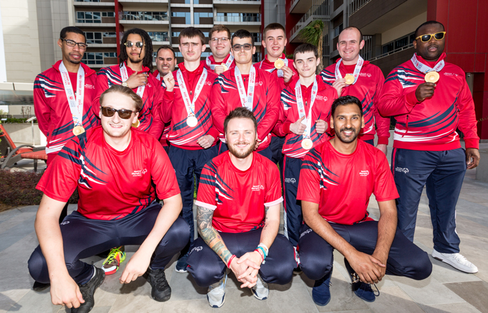 The Special Olympics GB Men's Basketball Team with their medals.