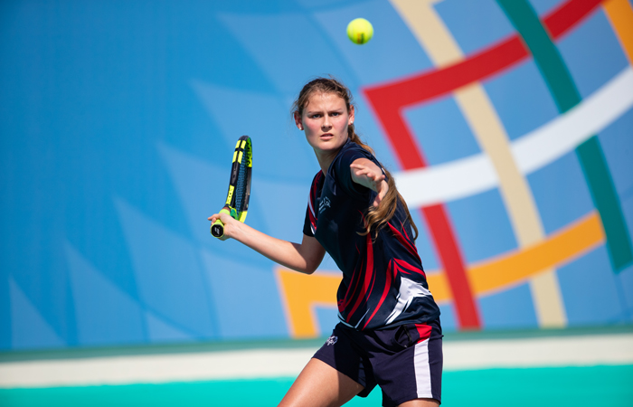 Special Olympics GB Athlete Lily Mills playing tennis at the World Games in Abu Dhabi