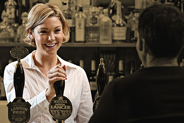 Woman serving beer at the bar